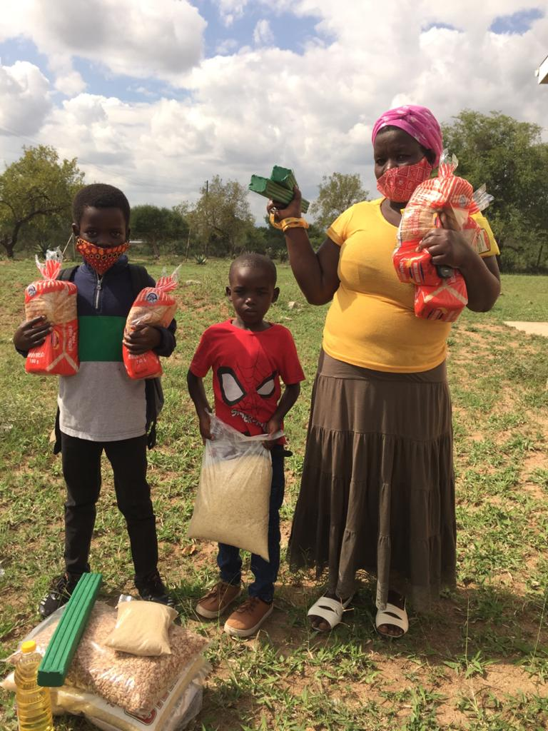 A mother with her 2 children receive their emergency response kit.