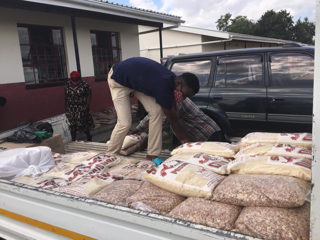 Unloading bags of beans