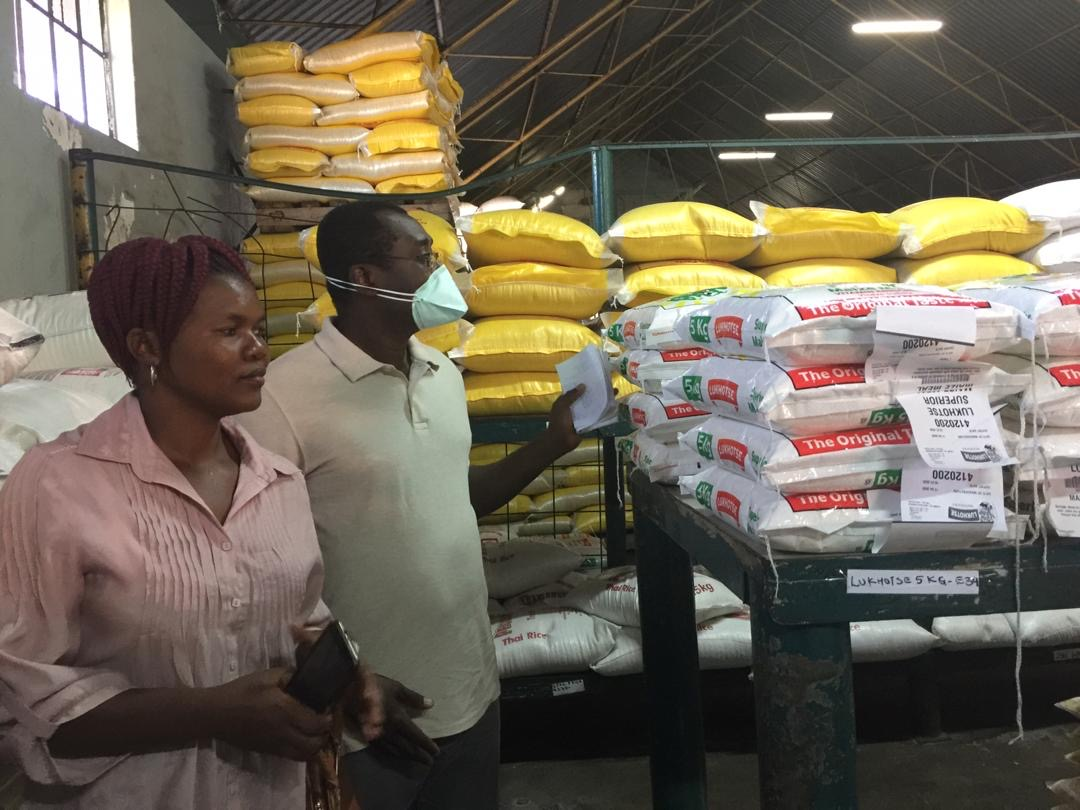 Delisile and Joe purchasing for her village.